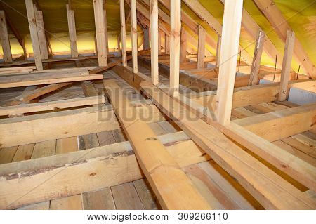 Roofing Construction Attic Insulation Interior. Wooden Roof Beams, Roof Truuses,  Frame House Attic