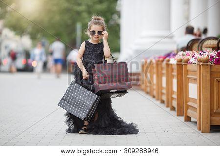 Cute Little Caucasian Girl Child Having Shopping Fun.fashion Trend. Fashion Shop. Little Girl With B