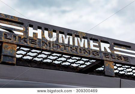 Samara, Russia - May 18, 2019: Hummer Car Logo And Slogan Against The Sky