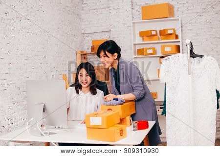 Two Young Asian Adult Fashion Business Female Merchant Sellers In The Office Working At Online Busin