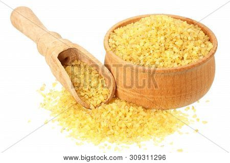Dry Bulgur Wheat In Wooden Bowl Isolated On White Background. Top View