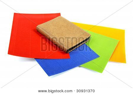 Notebook on sheets of the goffered cardboard isolated poster