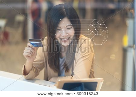Asian Women Using The Technology Tablet For Access Control By Face Recognition In Private Identifica