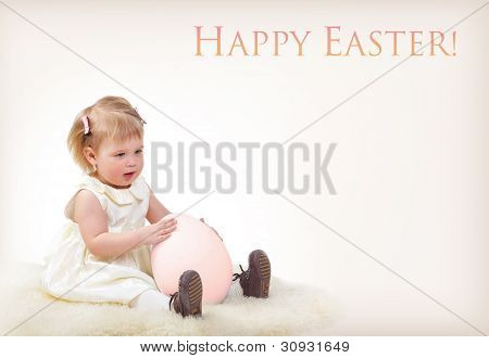 Cute baby girl with big easter egg