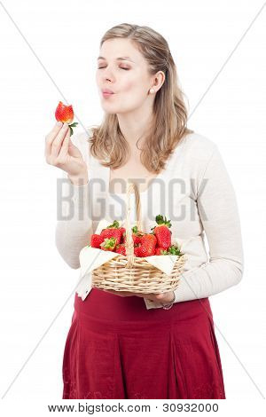Woman Enjoying Fresh Strawberries