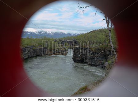 Unusual Shot Through A Colored Tube, The Stream Abiskojakka Can Be Seen.