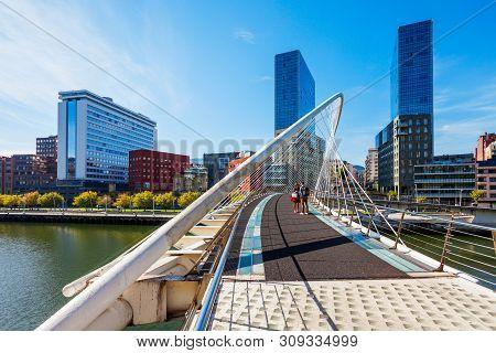 Bilbao, Spain - September 28, 2017: Zubizuri Bridge Through Nervion River In The Centre Of Bilbao, B