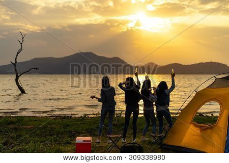 Silhouette.group Women Party With Drink Alcohol Enjoy At Camping.vacation Time At Sunset