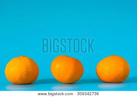 Summer Of Orange Fruit On Blue Background.
