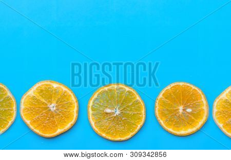 Summer Of Slice Orange Fruit On Blue Background.