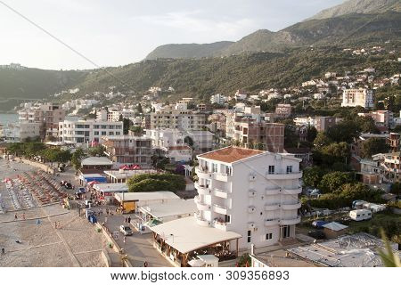 Dobra Voda, Montenegro - June 20, 2018: Top View Of The Illuminated By The Setting Rays Of The Sun T