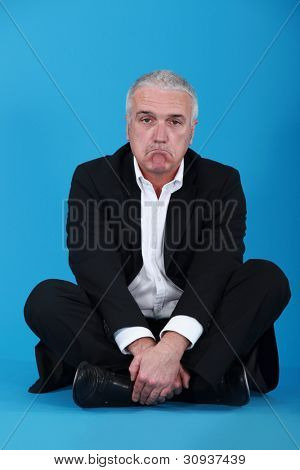 Glum businessman