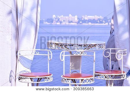 Udaipur, Rajasthan, India - 1 July 2019: Abstract Background Of Table Setting At Lake View Restauran