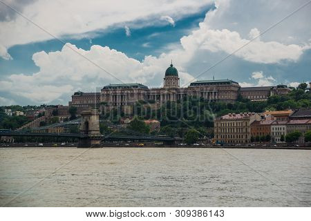 poster of Budapest, Hungary: View of Buda Castle, the historic Royal Palace in Budapest. Historical castle and palace complex on the south tip of Castle Hill in the Castle District.