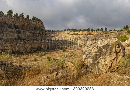 A Deserted Quarry Near Jerusalem, Israel. Nature Slowly Reclaims The Place, Pine Trees And Vegetatio