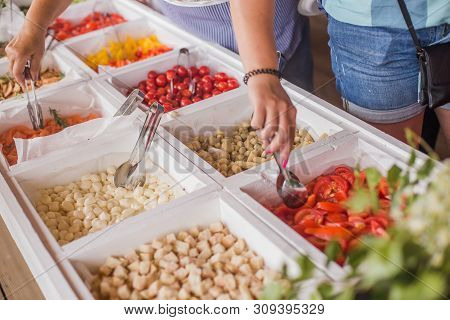 Buffet Line Assorted Natural And Organic Salmon Fish, Young Mozzarella Cheese, Vegetables Served To