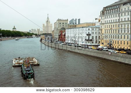 Moscow, Russia - 15.05.18 : Stalin Skyscraper On The Background Of The River With A Boat. Moscow Riv