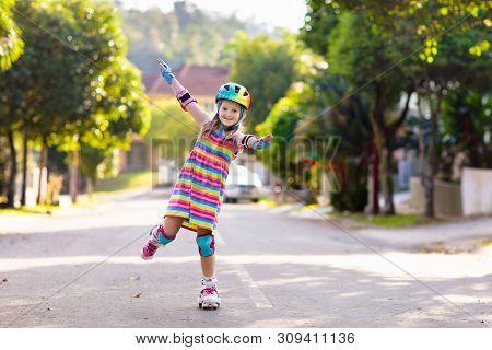 Child On Inline Skates. Kids Skate Roller Blades.