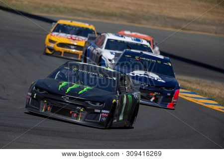 June 23, 2019 - Sonoma, California , USA: Kurt Busch (1) races for position for the TOYOTA/SAVE MART 350 at Sonoma Raceway in Sonoma, California .