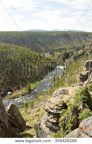 Rapid Mounting River Racing Down The Mountains Of Wyoming, Usa