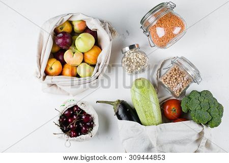 Zero Waste Food Storage Eco Bag Top View. Reusable Cotton Bag With Fresh Vegerables, Fruits, Berry,