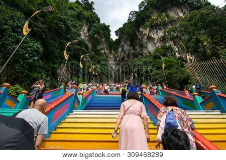 Selangor, Malaysia - December 8, 2018: View Of Travelers Clime Up To The Top Of Batu Caves, Where Is