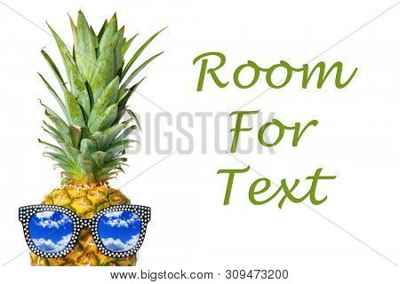 Pineapple. Pineapple Peak. A Sunglasses wearing Pineapple peaks from a white background. Pineapple with sunglasses. Isolated on white. Room for text. clipping path.