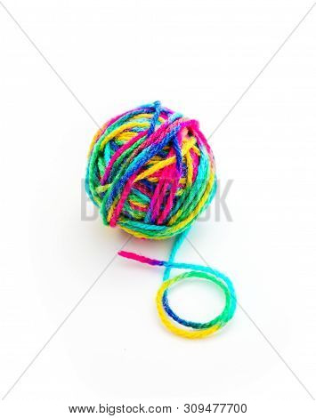 Colorful Threat In A Ball Of Yarn, End Of Thread, Isolated On White Background. Handicraft Knitting