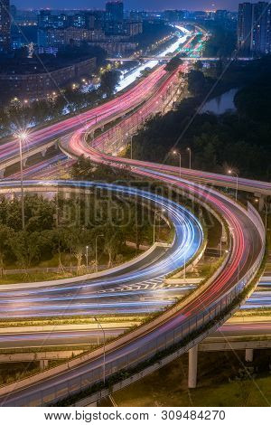 Large Interchange With Busy Traffic Aerial View At Night In Chengdu, China