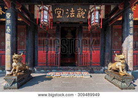 Chengdu, Sichuan Province, China - June 6, 2019 : Bronze Dragon Statues In Front Of A Buddhist Templ