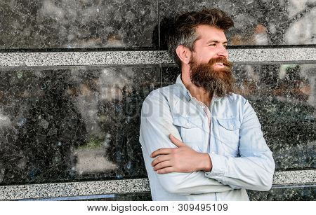 Beard Grooming. Man Attractive Bearded Hipster Posing Outdoors. Masculinity And Manliness. Confident