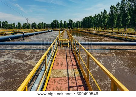 Modern wastewater treatment plant. Tanks for aeration and biological purification of sewage by using active sludge poster