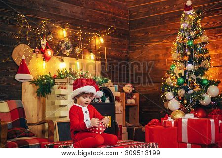 Boy Cute Child Cheerful Mood Play Near Christmas Tree. Family Holiday. Merry And Bright Christmas. L
