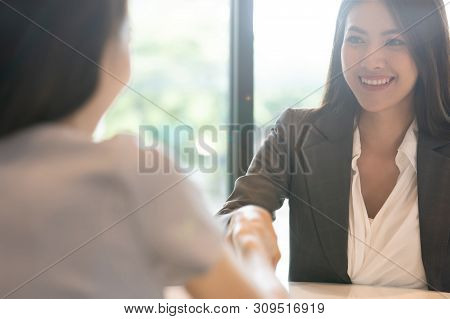 Portrait Young Asian Woman Interviewer And Interviewee Shaking Hands For A Job Interview .business P