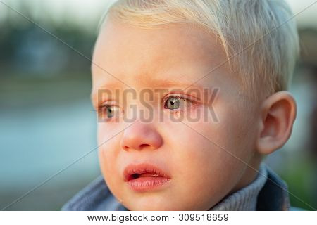 Little Boy With Tears Close Up Defocused Background. Emotional Sad Baby. Toddler Sad Face Crying. Sa