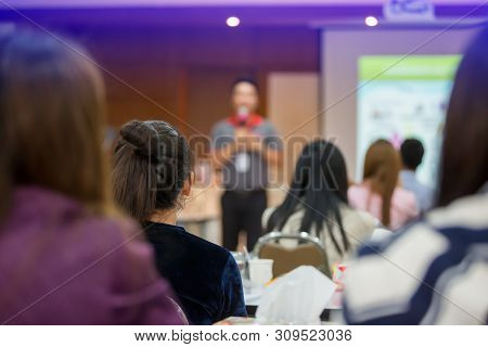 Selective Focus To Business Woman With Blurry Man Speaker For Meeting Or Seminar Event In The Meetin