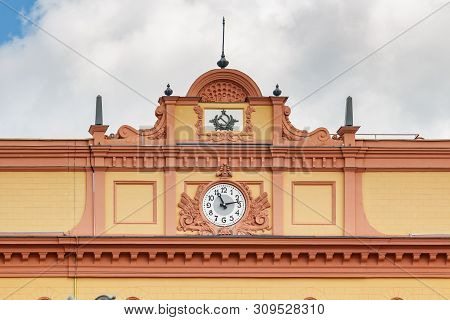 Moscow, Russia - June 02, 2019: Clock Under Roof On The Facade Of Building Of Kgb On Lubyanka Square