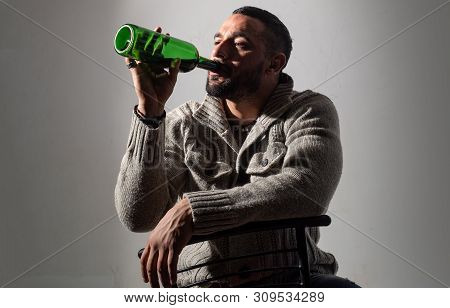 Alcoholism, Alcohol Addiction And People Concept. Male Alcoholic With Wine Bottle. Alcohol Abuse. Dr