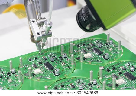 The Robotic System For The Soldering Process With The Electronics Board. The Electronics Circuit Boa