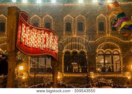 Moscow, Russia - December 06, 2017: Luminous Sign Of Beverage Producer Nicola. Christmas Market On R