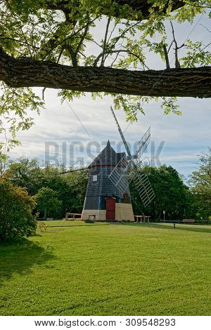 Eastham, Ma - June 12, 2019: The Eastham Windmill, Shown Here With Repairs Being Made To The Siding,