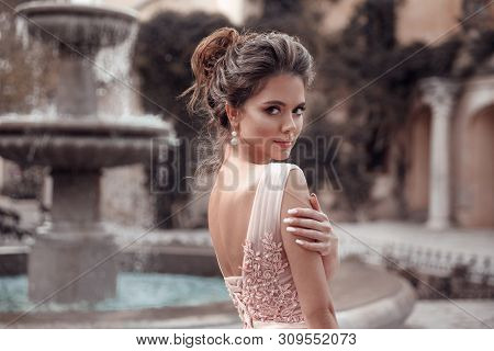 Beautiful Bride With Pearl Earrings Jewelry Wears Pink Prom Dress. Outdoor Romantic Portrait  Of Att