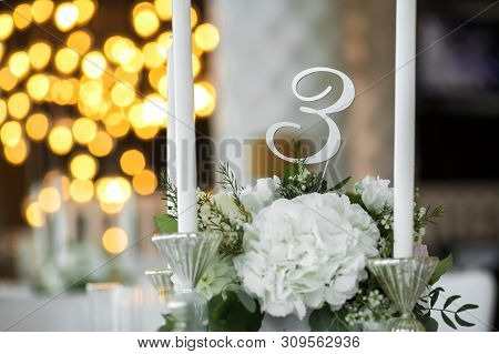 Wedding Table Setting Is Decorated With Fresh Flowers And White Candles. Wedding Floristry. Bouquet