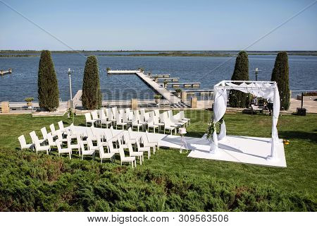 Beautiful Outgoing Wedding Set Up. Jewish Hupa  On Romantic Wedding Ceremony , Wedding Outdoor On Th