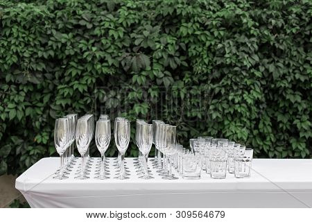 Many Empty Clean Glasses For Guests At The Buffet Festive Wedding Table.