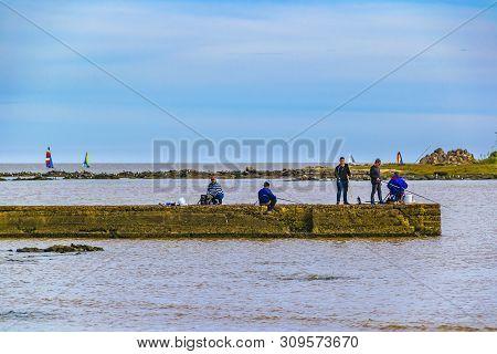 People Fishing At Breakwater, Montevideo, Uruguay