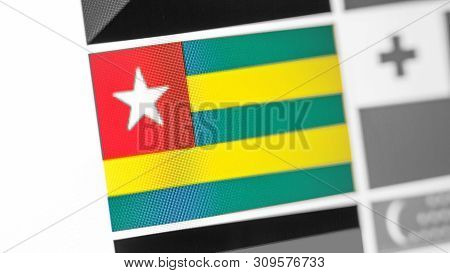 Togo National Flag Of Country. Togo Flag On The Display, A Digital Moire Effect. News Of Geography A