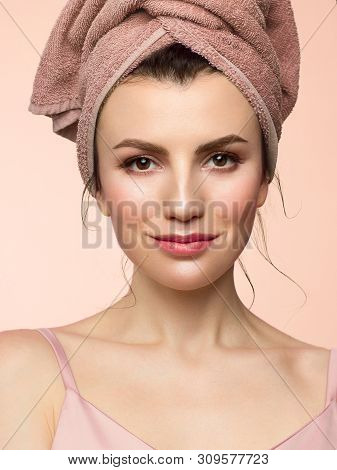 Beauty Close-up With Day Makeup. Pure, Radiant Skin Of The Face, A Towel On His Head And A Slight Pl