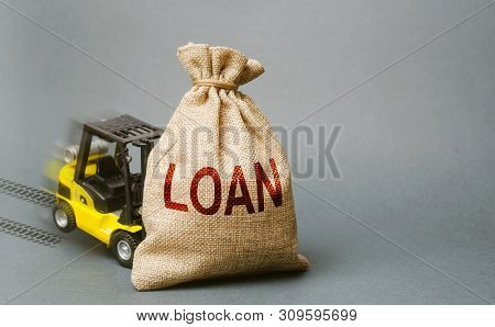 Yellow Forklift Truck Crashed Into The Bag With The Word Loan And Can Not Lift It. Inability To Repa