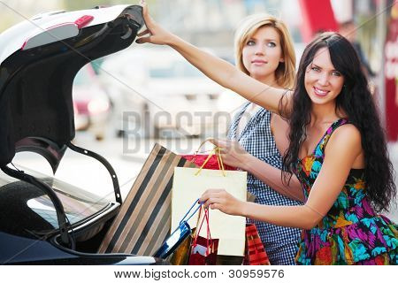 Two young shoppers in a car parking